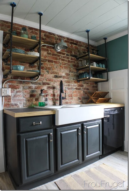 Kitchen Sink Wall with Exposed Brick and Painted Cupboards