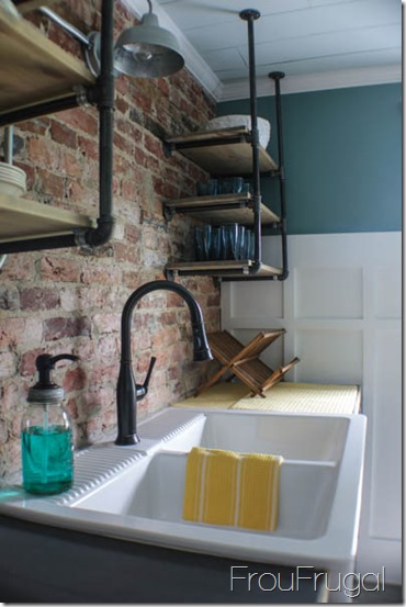 Kitchen Remodel - After - Exposed Brick Wall with Plumbing Pipe Open Shelves